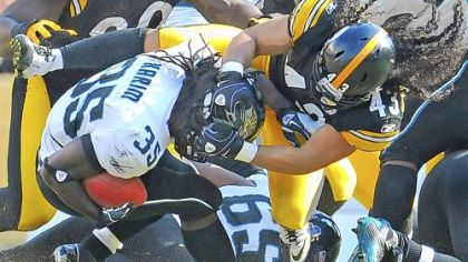 Troy Polamalu tackles Jaguars running back Deji Karim for a loss in the second quarter Sunday at Heinz Field. Polamalu passed a concussion test and is cleared to play this Sunday in Arizona.