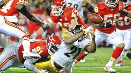 Mewelde Moore fumbles the ball in the first quarter as he stretches for the goal line. The Chiefs recovered in the end zone, negating the Steelers' first scoring chance of the night.