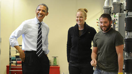 President Obama shares a laugh with IBEW second-year apprentices Cara Erskine and Ryan Cumberland during a tour of classrooms at the IBEW training center on the South Side.