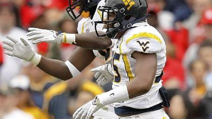 West Virginia's Darwin Cook and Keith Tandy celebrate a big play vs. Maryland.
