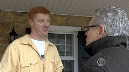 Penn State assistant football coach Mike McQueary, left, speaks to CBS News correspondent Armen Keteyian on Tuesday. Mr. McQueary is cited by a grand jury report as witnessing Jerry Sandusky sodomizing a 10-year-old boy in a Penn State locker room in 2002.