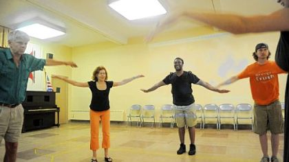 "From left, Chrisopher Josephs, Thalia Snyder, Monteze Freeland and Eric Anderson warm up before rehearsing a flying scene from ""Camino."""