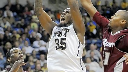 Pitt&#039;s Nasir Robinson drives to the basket between Rider&#039;s Novar Gadson and Brandon Penn in the second half Sunday night at the Petersen Events Center.