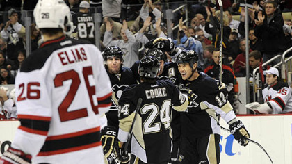 The Penguins&#039; Jordan Staal is congratulated by Matt Niskanen, Matt Cooke and Richard Park after scoring a power play goal against the Islanders.