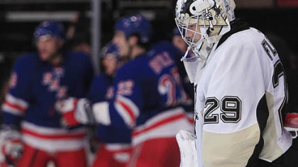Penguins goalie Marc-Andre Fleury  reacts after New York Rangers center John Mitchell scored a goal.