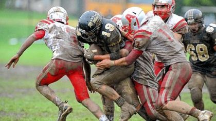 The Avonworth High School defense stops a run by Riverview's Tim Wagner, middle, on a rainy Saturday. The Antelopes shut Riverview out, 26-0.