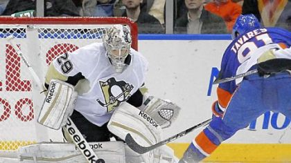 Penguins goalie Marc-Andre Fleury stops a shot by New York&#039;s John Tavares -- one of the 33 saves he made en route to his 20th career shutout in the Penguins&#039; 3-0 victory Tuesday in Uniondale, N.Y.