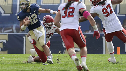 Pitt quarterback Tino Sunseri is tripped up by Utah's LT Tuipulotu in the second quarter at Heinz Field this afternoon.