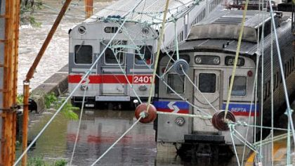 Two Southeastern Pennsylvania Transportation Authority trains sit in water on flooded tracks at Trenton train station on Sunday, in Trenton, N.J.