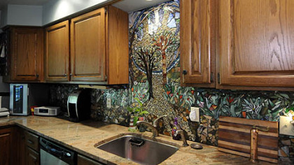 The kitchen features a glass mosaic backsplash created by local artist Daviea Davis.