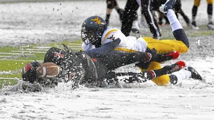Rutgers' Quran Pratt, left, can't hold onto a pass in the snow after being hit by West Virginia's Pat Miller.