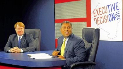Rich Fitzgerald (left) and D. Raja during a break in the Allegheny County executive debate Thursday at Robert Morris University.
