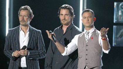 "Gary Oldman, left, Christian Bale and Joseph Gordon-Levitt talk up ""The Dark Knight Rises"" during the 2012 MTV Movie Awards."